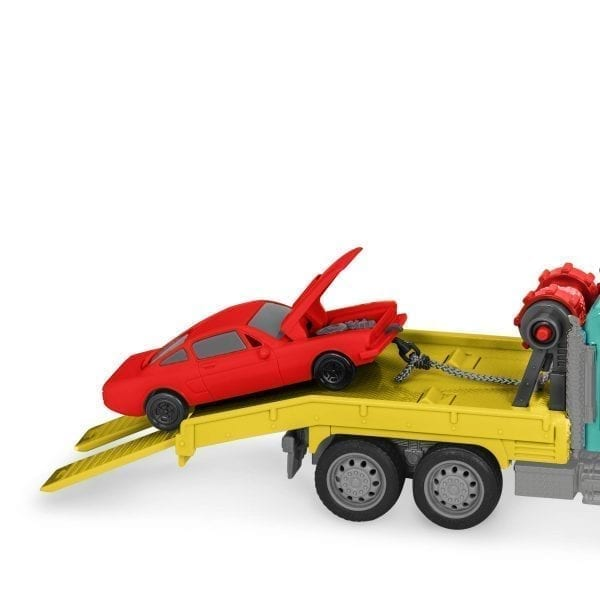 Toy car on toy tow truck.