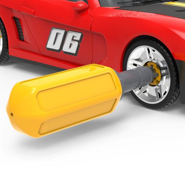 Mini screwdriver in wheel of take-apart sports car toy.